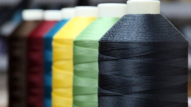Bonded Nylon and Bonded Polyester are popular upholstery threads