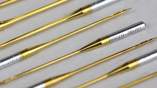 Superior's titanium-coated needles fit all home sewing machines