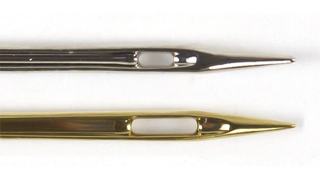 A universal needle (top) and Superior topstitch needle (bottom)