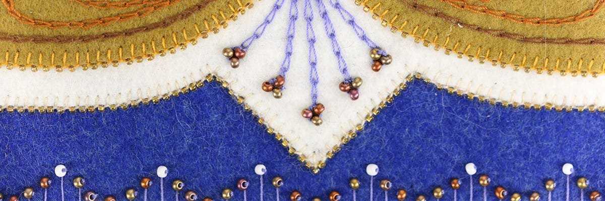 Wool applique with beads
